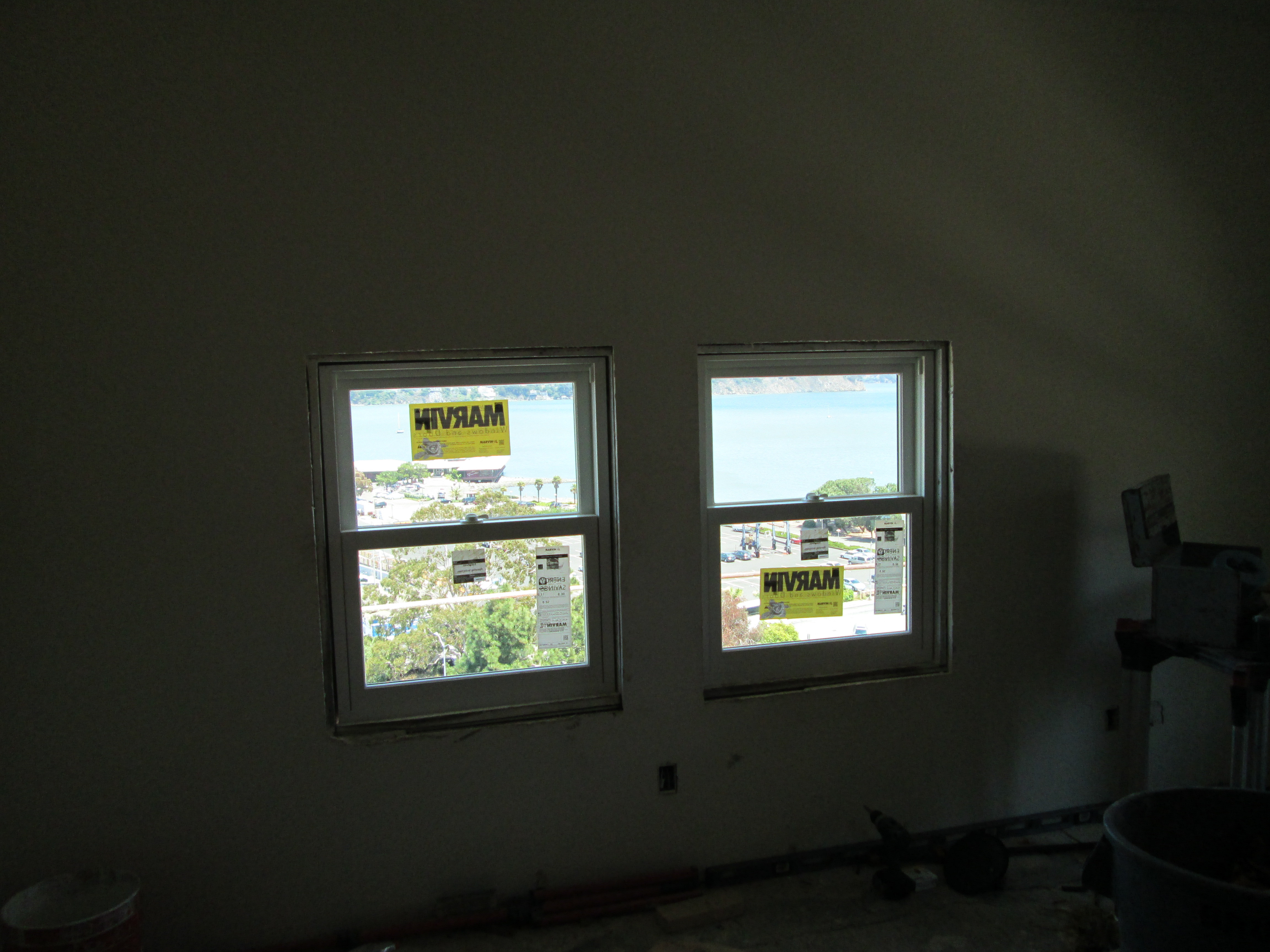 Marvin window install in historic hotel ot glass for Marvin transom windows