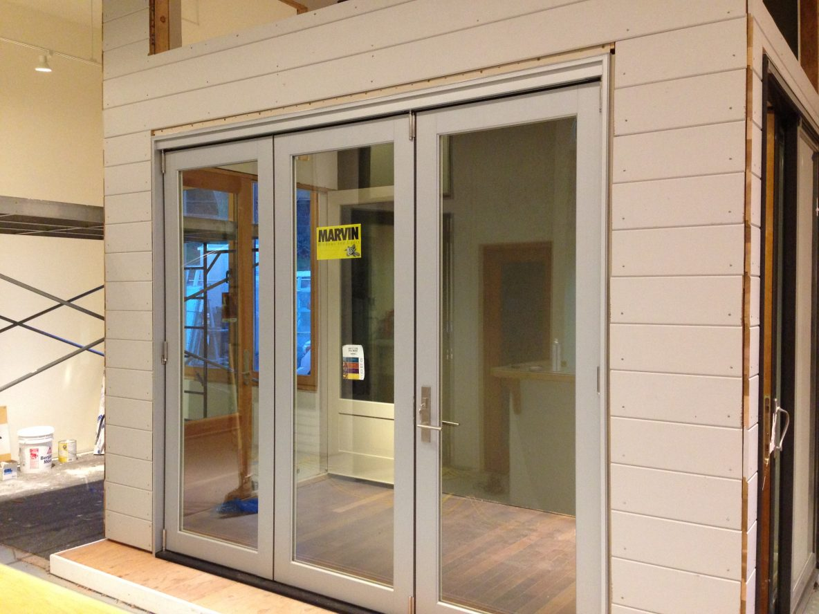 Showroom Addition Marvin Bifold Door With Contemporary Panel Ot Glass
