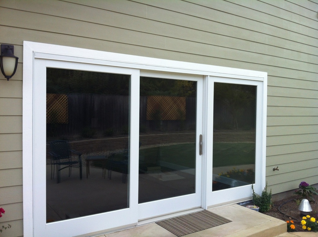 Marvin three panel clad sliding french door ot glass for Sliding glass door to french door