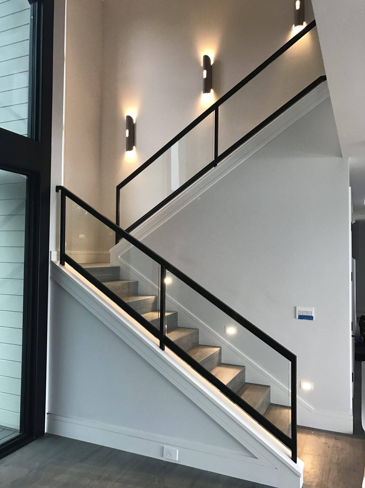 Interior Steel and Glass Railing on Stairs in Tiburon Project