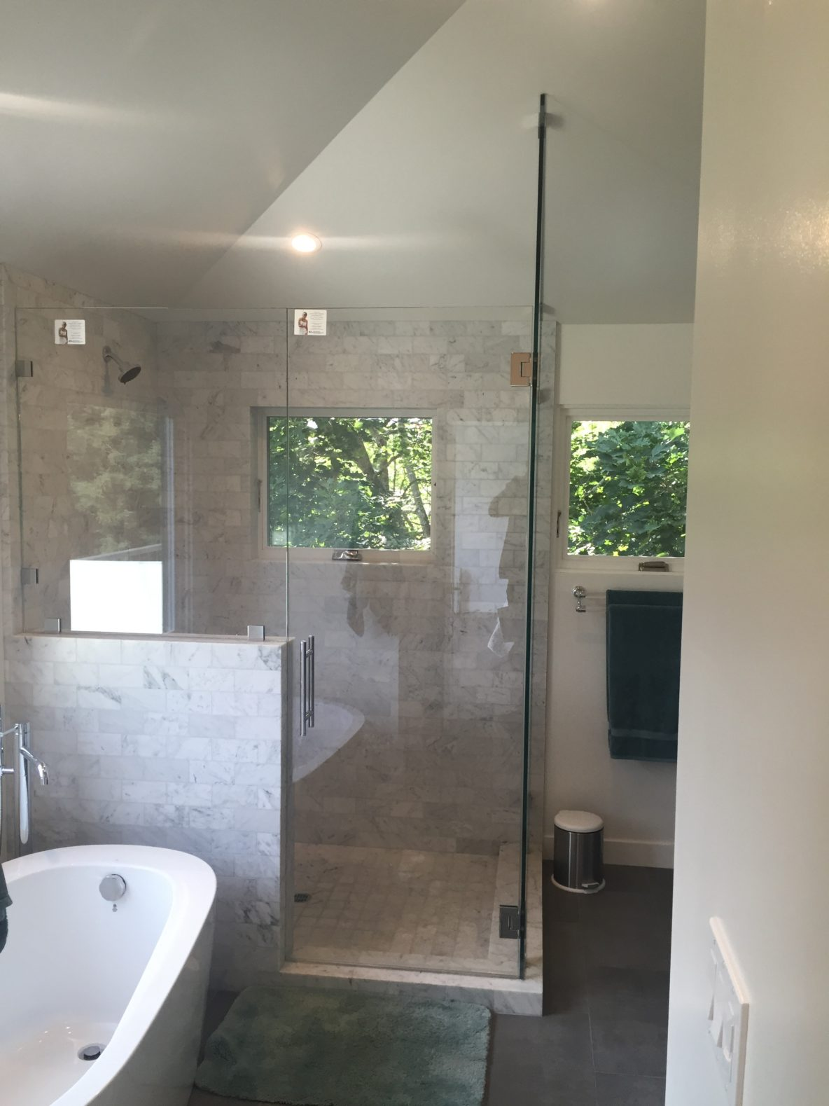 Unique application with Guardian Showerguard. A 90 degree corner unit that follows the rake of the ceiling, with a fixed panel on the pony wall.