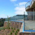 Glass deck railing - stone inset 11