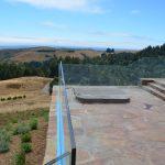 Glass deck railing - stone inset 10