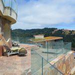 Glass deck railing - stone inset 8