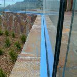 Glass deck railing - stone inset