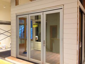 Showroom Addition: Marvin Bifold Door with Contemporary Panel