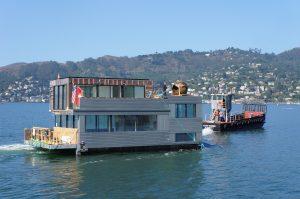 Floating Dreams Moving Across Bay Tug Boat