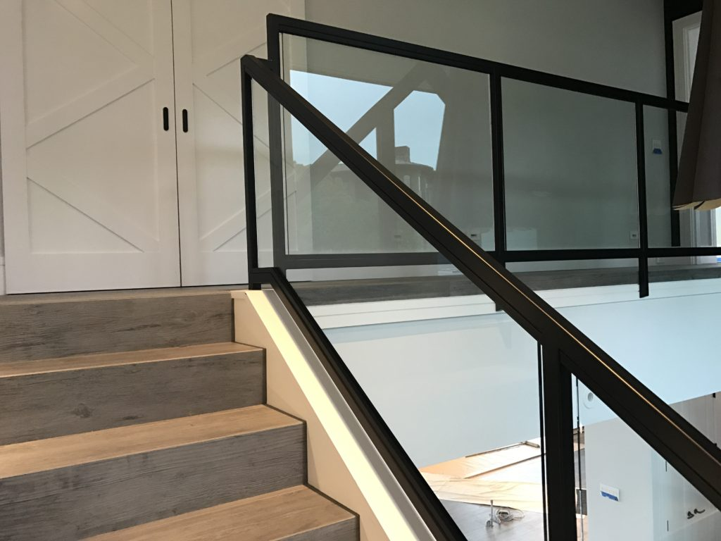 Glass panels used to infill a tubular steel railing.