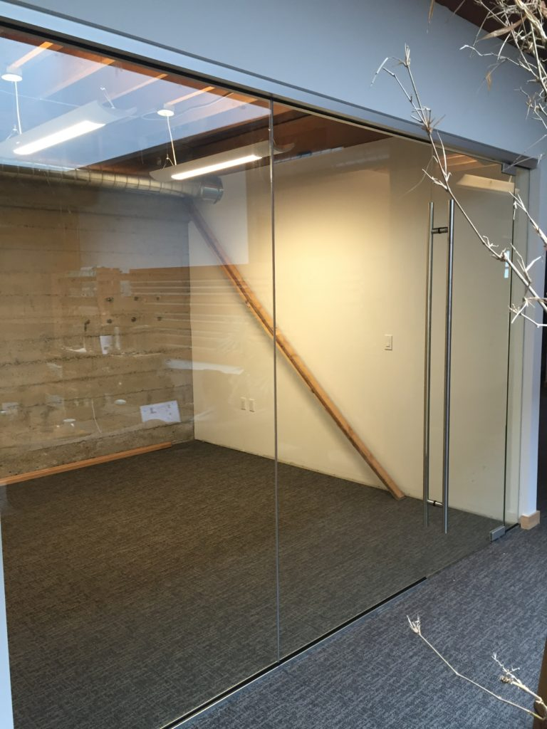 Utilizing low profile satin anodized hardware, all glass conference rooms and offices were created.