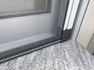 Unique retractable screen with integrated sill.