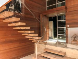 floating staircase with glass railing