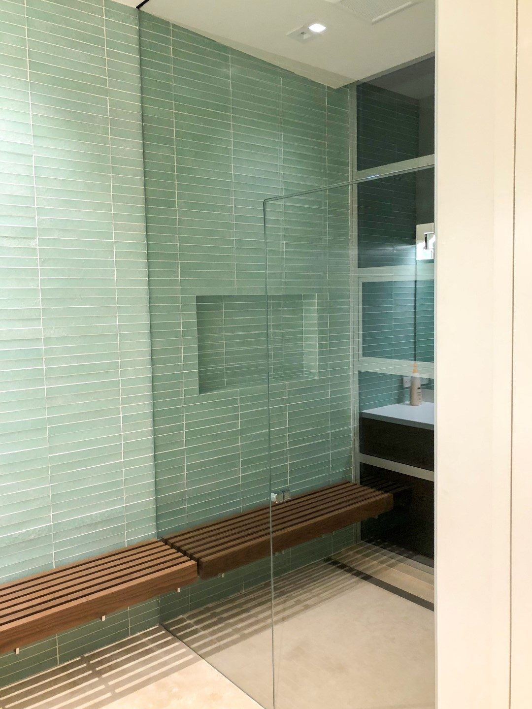 glass bathroom with seating